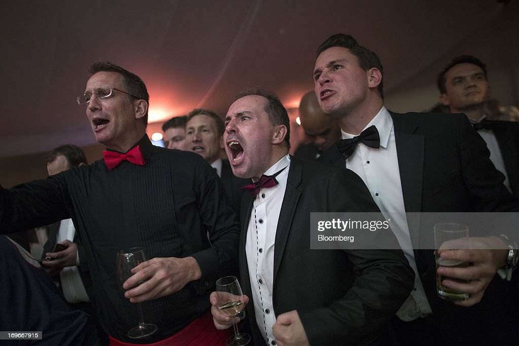 Boxing fans cheer during the Hedge Fund Fight Nite 2013 charity fighting event in Hong Kong, China, on Thursday, May 30, 2013. The event raises money for Operation Breakthrough and Operation Smile charities. Photographer: Jerome Favre/Bloomberg via Getty Images
