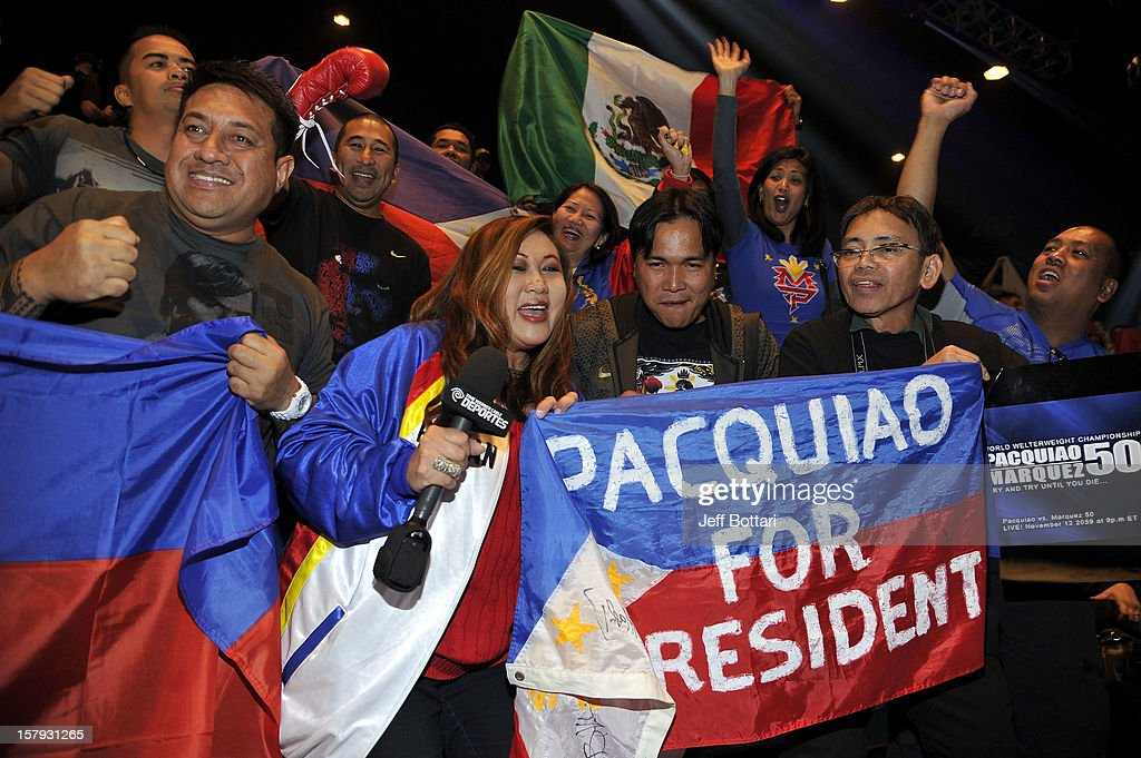 Boxing fans support boxer Manny Pacquiao during the official weigh-in for his welterweight bout against Juan Manuel Marquez at the MGM Grand Garden Arena on December 7, 2012 in Las Vegas, Nevada. Pacquiao and Marquez will fight each other for the fourth time on Dec. 8 in Las Vegas.