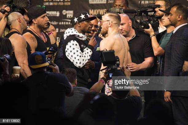 Floyd Mayweather Jr and Conor McGregor on stage to promote their upcoming Super Welterweight fight during New York leg of press tour at Barclays...
