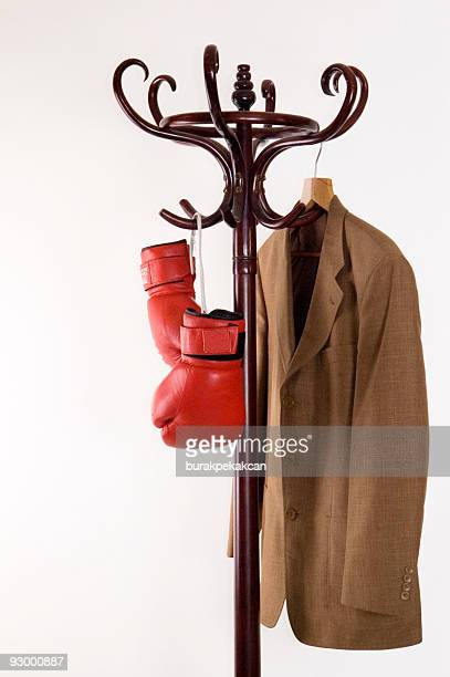 Boxing gloves and  jacket on a hanger
