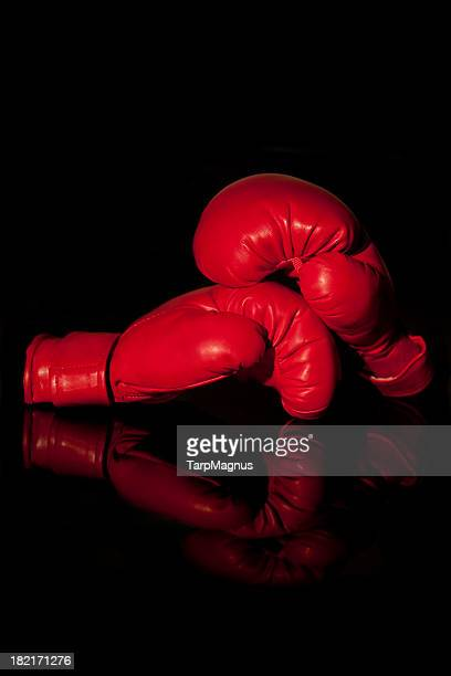 Boxing gloves at black background