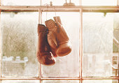 Boxing gloves hanging on window