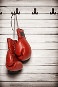 Boxing gloves hanging on wooden wall -including clipping path