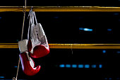 boxing gloves hangs off the boxing ring in a slum campboxing gloves hangs off the boxing ring in a slum camp