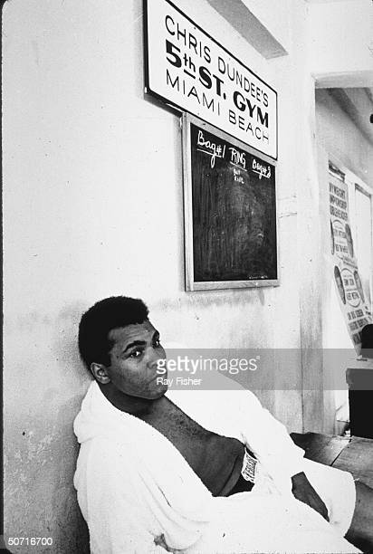 Boxing great Cassius Clay aka Muhammad Ali resting during training for first Frazier fight
