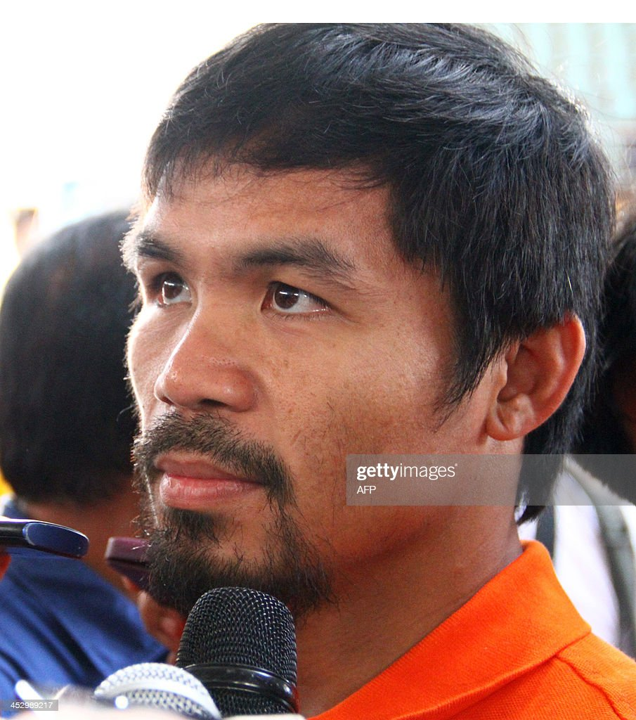 Boxing hero Manny Pacquiao visits an evacuation center in Tacloban City on December 2, 2013, among the hardist hit by Super typhoon Haiyen in Central Philippines last November 8. Philippine boxing hero Pacquiao handed out Bibles, tinned food and cash to lift people's spirits in areas devastated by the typhoon.