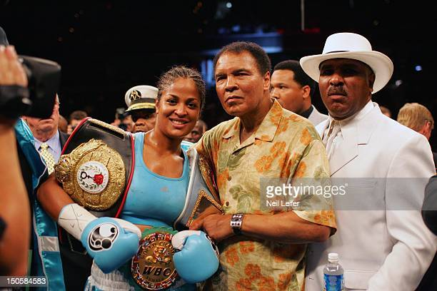 IBA/ WBC Super Middleweight Title Laila Ali victorious with her father Muhammad Ali after winning fight vs Erin Toughill at MCI Center Washington DC...