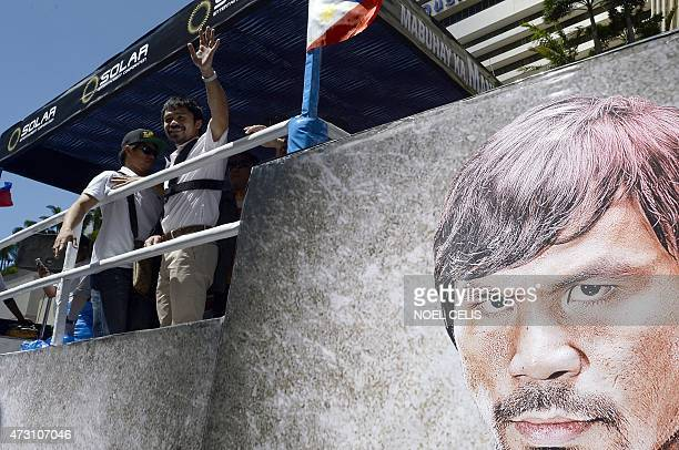 Boxing icon Manny Pacquiao of the Philippines waves to his supporters during a welcome parade in Manila on May 13 2015 Manny Pacquiao made a lowkey...