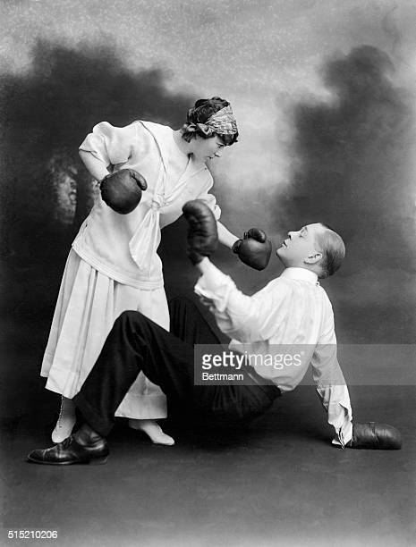 Boxing image of young lady flooring her Beu Photo 1910