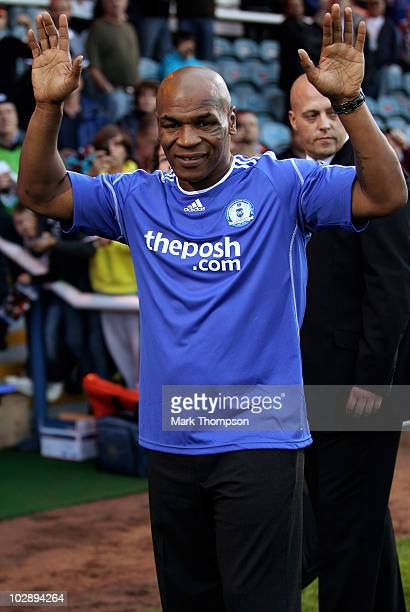Boxing legend Mike Tyson puts in an appearance at half time during the preseason friendly match between Peterborough United and West Ham at London...