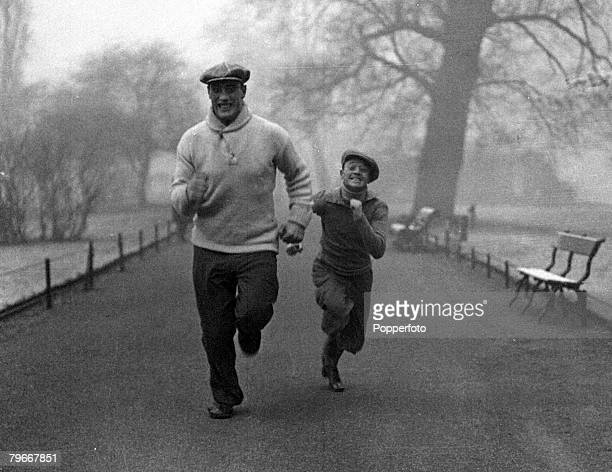 Boxing London England 10th March Italian heavyweight boxer Primo Carnera runs in St James park during training in london with trainer Maurice...