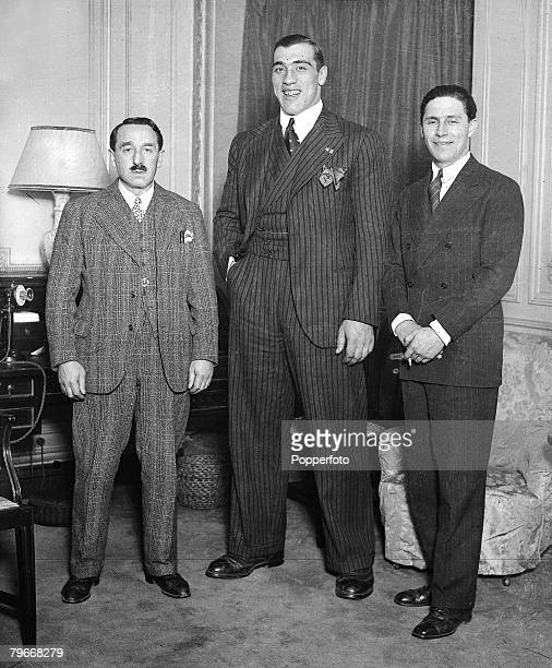 Boxing London England 13th December Italian heavyweight boxer Primo Carnera stands with his manager Leon See and promoter Jeff Dickinson at London's...