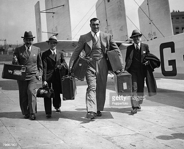 Boxing London England 21st May Italian heavyweight champion boxer Primo Carnera carrying his suitcases as he arrives at Croydon aiport with his...