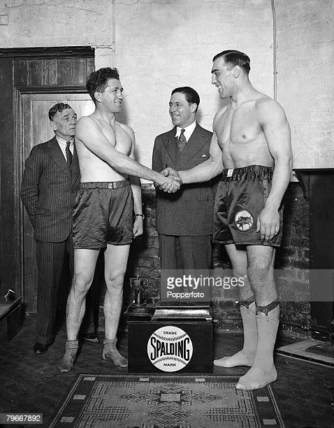 Boxing London England 7th April Italian heavyweight boxer Primo Carnera shakes hands with South African boxer Donald McCorkindale at the weigh in...
