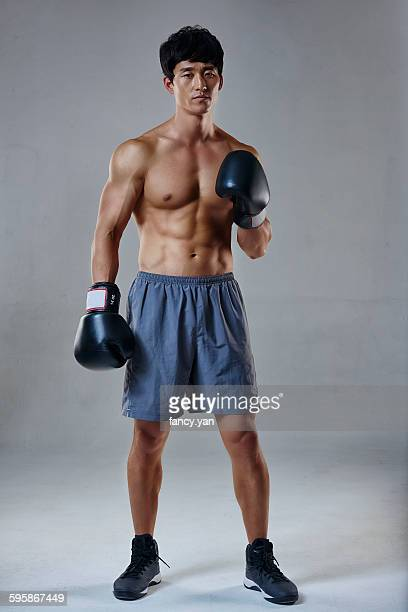 Boxing male in sweatpants