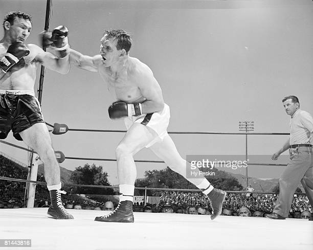 Boxing NBA World Middleweight Title Gene Fullmer in action throwing punch vs Carmen Basilio at Derks Field Salt Lake City UT 6/29/1960