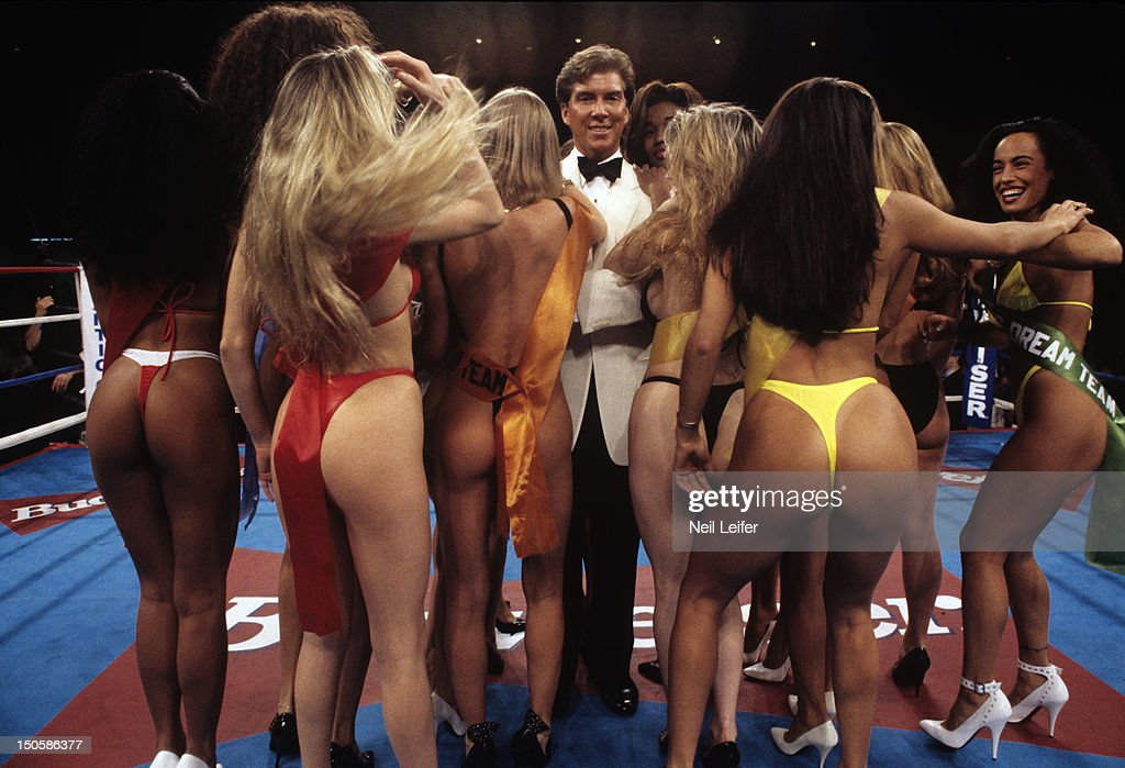 Portrait of announcer Michael Buffer surrounded by card girls in ring during fights at Boardwalk Convention Hall Atlantic City NJ CREDIT Neil Leifer