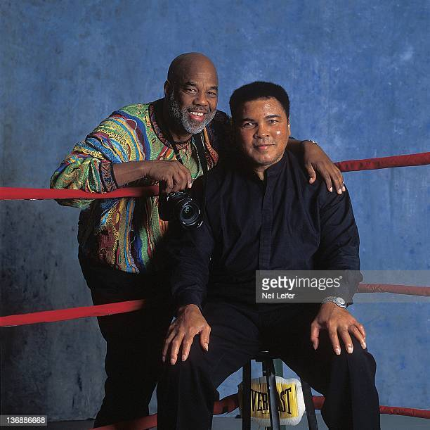Boxing Portrait of former heavyweight champion Muhammad Ali with photographer and friend Howard Bingham during photo shoot at his farm on Kephart...