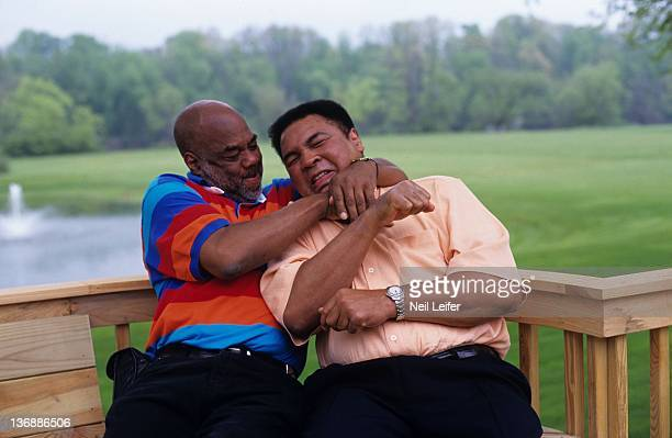 Boxing Portrait of former heavyweight champion Muhammad Ali with his photographer and friend Howard Bingham during photo shoot at his farm on Kephart...