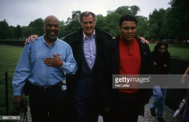 Portrait of former heavyweight champion Muhammad Ali with his friend photographer Howard Bingham and Sports Illustrated writer Frank Deford during...