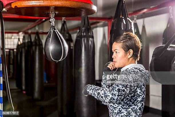Boxing: Practice with a Speed Bag in a Boxing Gym
