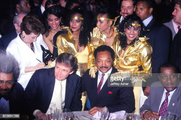 Boxing Promoter Don King Businessman Donald Trump and The Reverend Jesse Jackson with unknown singers from hotel lounge act at Tyson vs Holmes pre...
