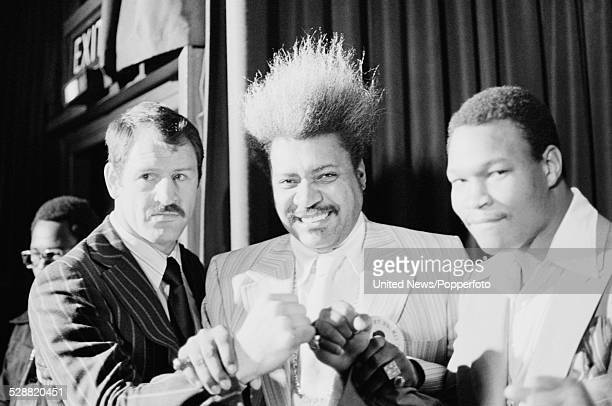 Boxing promoter Don King stands between English heavyweight boxer Paul Sykes on left and American heavyweight boxer Larry Holmes on right in London...