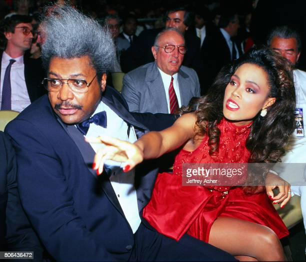Boxing Promoter Don King with Actress Robin Givens ringside at Tyson vs Holmes Convention Hall in Atlantic City New Jersey January 22 1988