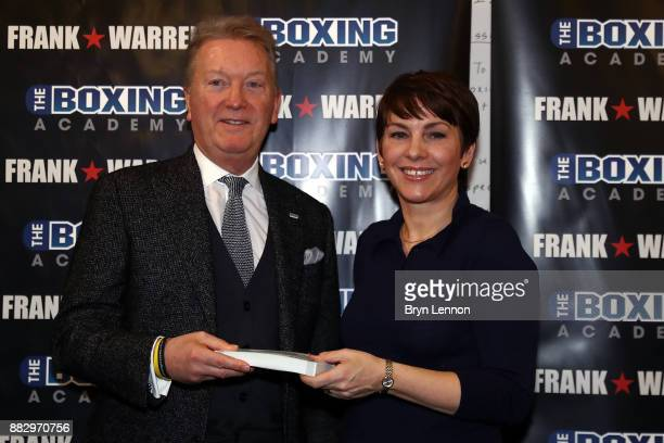 Boxing Promoter Frank Warren presents some tickets to Anna Cain CEO of the Boxing Academy during a Boxing Academy Press Conference on November 30...