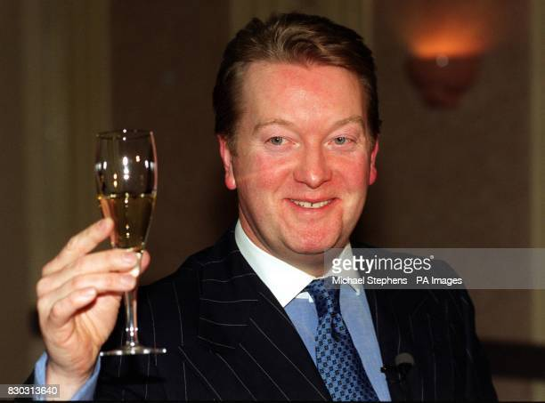Boxing promoter Frank Warren raises a glass of champagne at a press conference in London after hearing that the home secretary Jack Straw was...