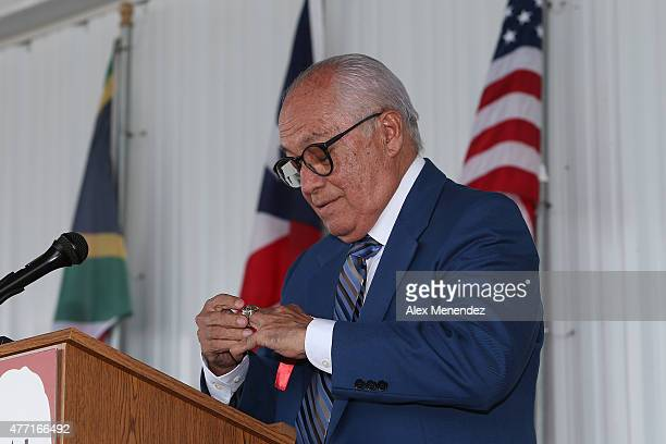 Boxing promoter Rafael Mendoza puts on his ring as he speaks during the induction ceremony at the International Boxing Hall of Fame induction Weekend...