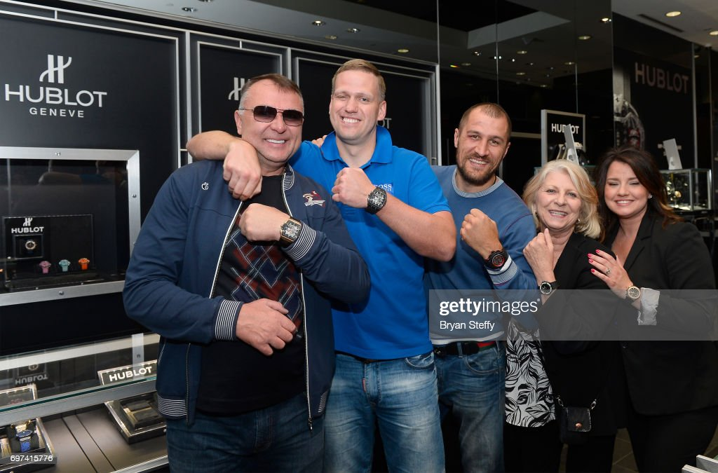Boxing trainer Egis Klimas, Andrius Krukonis and boxer and Hublot ambassador Sergey Kovalev pose with employees during their visit the Hublot Boutique at The Forum Shops at Caesars on June 18, 2017 in Las Vegas, Nevada.