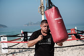 Boxing trainer Moacyr Lima hits a sandbag next to a beach boxing ring at Pepe beach in Rio de Janeiro Brazil on July 26 2016 Since Lima first...
