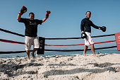 Boxing trainer Moacyr Lima trains a man inside a beach boxing ring at Pepe beach in Rio de Janeiro Brazil on July 26 2016 Since Lima first installed...