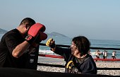 Boxing trainer Moacyr Lima trains a woman inside a beach boxing ring at Pepe beach in Rio de Janeiro Brazil on July 26 2016 Since Lima first...