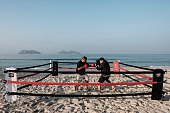 TOPSHOT Boxing trainer Moacyr Lima trains Leandro Guignoni in beach boxing at Pepe beach in Rio de Janeiro Brazil on July 26 2016 Since Lima first...