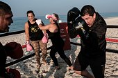 Boxing trainer Moacyr Lima trains people inside a beach boxing ring at Pepe beach in Rio de Janeiro Brazil on July 26 2016 Since Lima first installed...
