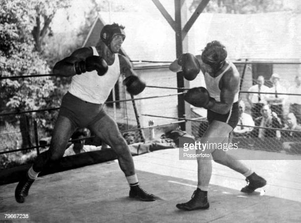Boxing USA 13th June Italian World Heavyweight boxing champion Primo Carnera in action with a sparring partner at his Pompton Lakes training camp New...