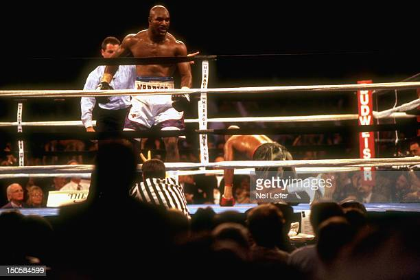 WBA/ IBF Heavyweight Title Evander Holyfield being led away by referee Mitch Halpern after knockdown of Michael Moorer at Thomas Mack Center Las...