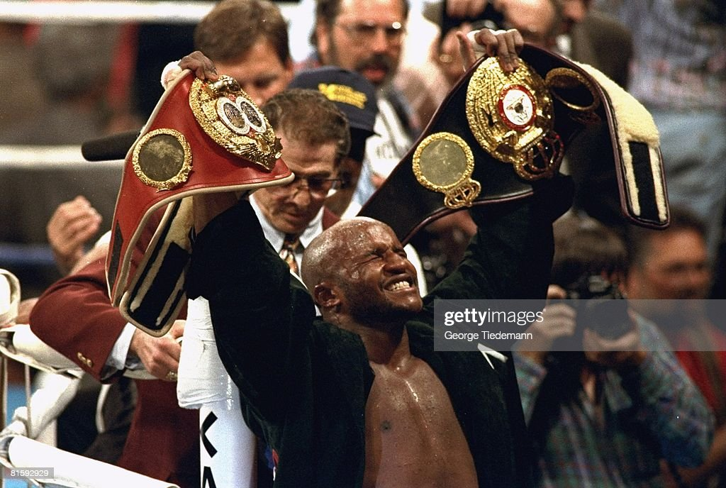 http://media.gettyimages.com/photos/boxing-wbaibf-heavyweight-title-michael-moorer-victorious-with-belts-picture-id81592929