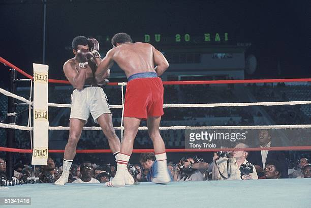 Boxing WBA/WBC Heavyweight Title Muhammad Ali in action taking punch vs George Foreman at 20th of May Stadium Kinshasa ZAR