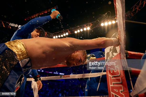 WBA/WBC/IBF/IBO Middleweight Title Canelo Alvarez being doused with water at his corner vs Gennady Golovkin during championship bout at TMobile Arena...