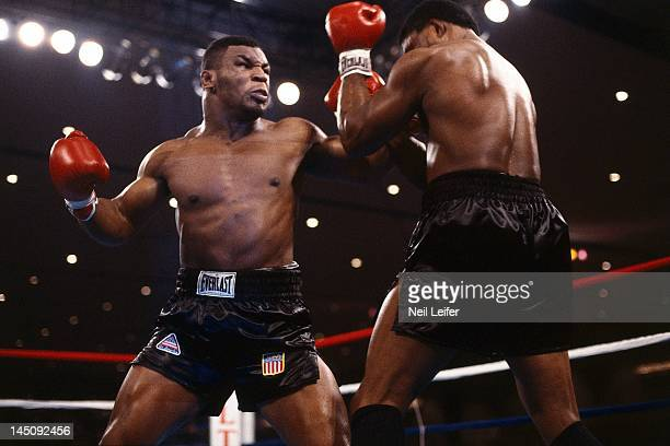 WBC Heavyweight Title Mike Tyson in action throwing punch vs Trevor Berbick during fight at Hilton Hotel Las Vegas NV CREDIT Neil Leifer