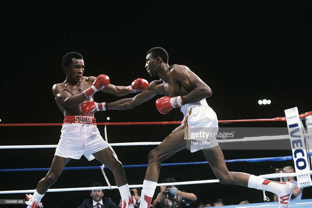 Sugar Ray Leonard (L) in action vs Thomas Hearns during fight at Sports Pavilion of Caesars Palace. Neil Leifer T30520 )