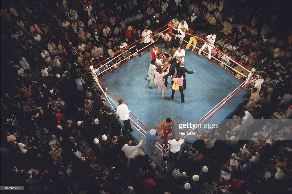 Aerial view of Muhammad Ali victorious with cornermen as fans begin to rush the ring after round 8 knockout of George Foreman at Stade du 20 Mai. Neil Leifer X19074 TK3 )