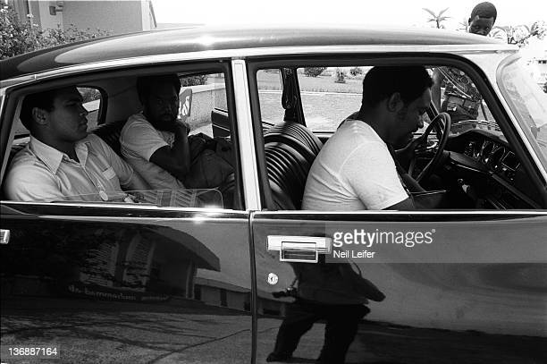 Boxing WBC/ WBA World Heavyweight Title Preview Muhammad Ali in car with photographer Howard Bingham while training before fight vs George Foreman at...