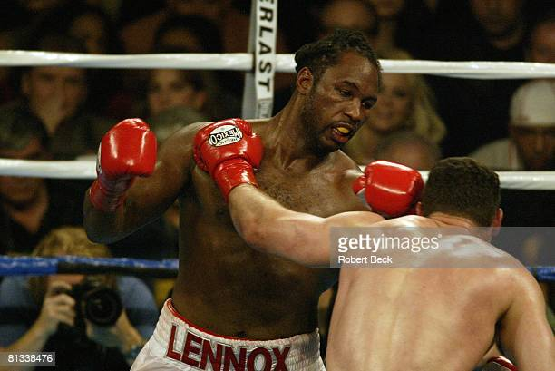 Boxing WBC/IBO Heavyweight Title Lennox Lewis in action during punch vs Vitali Klitschko at Staples Center Los Angeles CA 6/21/2003