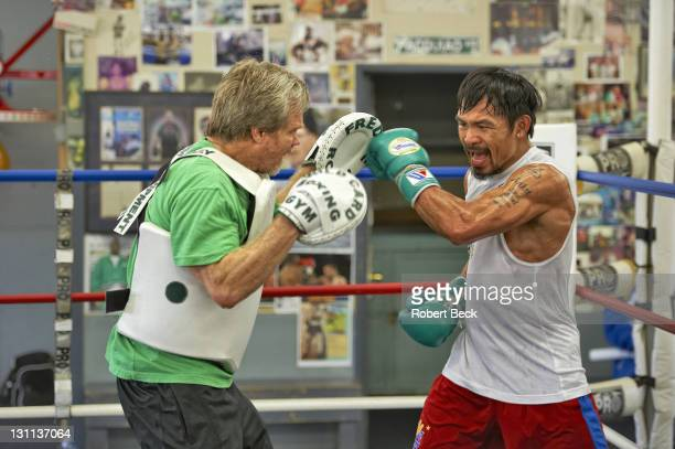 WBO Welterweight Title Preview Portrait of Manny Pacquiao sparring with trainer Freddie Roach before fight vs Juan Manuel Marquez at Wild Card Boxing...