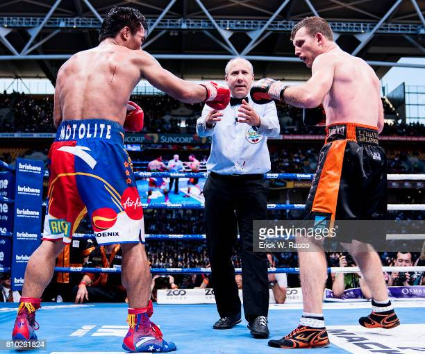 WBO World Welterweight Title Manny Pacquiao and Jeff Horn touch gloves at start of bout at Suncorp Stadium Brisbane Australia 7/2/2017 CREDIT Erick W...