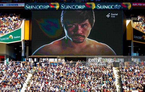 WBO World Welterweight Title View of face of Manny Pacquiao on video screen before bout vs Jeff Horn at Suncorp Stadium Overall view of fans in...